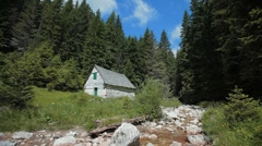 Stone mill near small mountain stream surrounded with pine forest. - stock footage