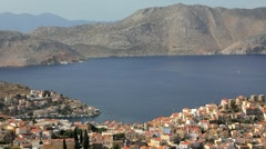 Symi Town Houses by the beautiful harbour, Symi Island, Greece Stock Footage