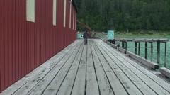 Cannery  dock,fisherman walking Stock Footage
