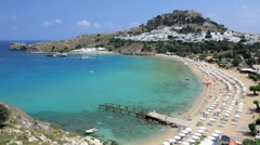 The beautiful Main beach in Lindos on Rhodes Island, Aegean Sea, Greece Stock Footage