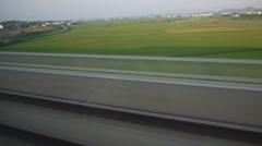 Landscape through train window - stock footage