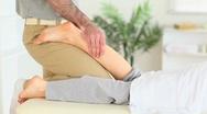 Man massaging a woman Stock Footage