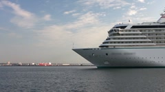 White luxury liner arriving at sea port from cruise timelapse Stock Footage