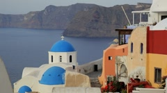 Blue Domed white washed churches of Oia, Santorini, Greece, Europe Stock Footage
