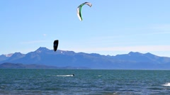 Kite surfers in the bay on a windy day Stock Footage