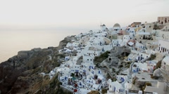 Sunset over the white washed houses of Oia, Santorini, Greece, Europe, T/Lapse Stock Footage