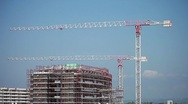 Cranes in action in a construction site - timelapse Stock Footage