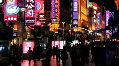 Neon signs above shops along Nanjing Road, Shanghai, China Stock Footage