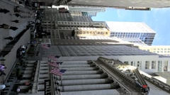 Wall Street New York with its ornate historic building, USA, Vertical view. Stock Footage