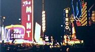 Stock Video Footage of LAS VEGAS NEON at Night 1960s (Vintage Film 8mm Retro Home Movie) 276
