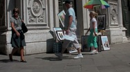 A street artist paints outside a cathedral in Paris. Stock Footage