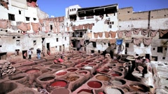 Vats for tanning and dyeing leather hides and skins, Fez, Morocco Stock Footage