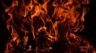 Stock Video Footage of Fire burning, close up view. Low key effect. Loop.