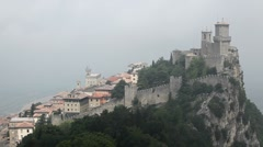 HD Aerial View of San Marino, Guaita Tower, Morning Fog, Castle, Old Town Hall Stock Footage