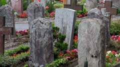 An old cemetery with ancient gravestones. Stock Footage