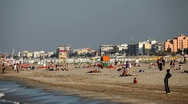 People at the beach, tourists population, sea, sunbathing, crowd tanning Stock Footage