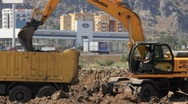 Yellow excavator and dumper truck Stock Footage