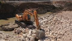 Big excavator operation in stone quarry Stock Footage