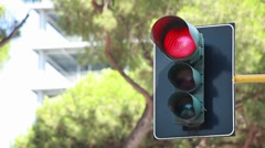 A traffic light regulating the city traffic, changing colors  Stock Footage