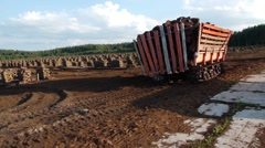Turf extraction site and equipment, peat bog, crawler trailer, caterpillar Stock Footage
