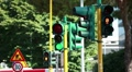Traffic-lights regulating the city traffic, changing colors  HD Footage