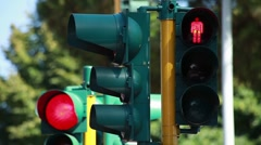 Traffic-lights regulating the city traffic, changing colors Stock Footage