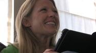 Beautiful bonde woman ipad Stock Footage
