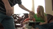Family and an ipad mom dad and son Stock Footage