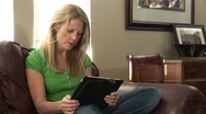 Little boy bumps his mom with her ipad Stock Footage