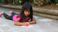 Stock Video Footage of Asian Girl Doing Sidewalk Chalk