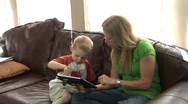 Stock Video Footage of Mom playin with her son on the ipad