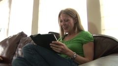 Pretty woman laughing and flirting with her ipad Stock Footage