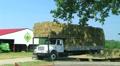 Truck Hauling Hay Bales HD Footage
