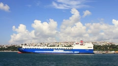 Large, blue ferry boat in Istanbul harbor Stock Footage