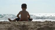 Boy on the beach Stock Footage