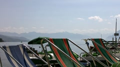 Sunchairs by the lake Stock Footage