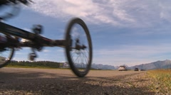 Busy highway traffic unique Quadricycle bike, low angle Stock Footage