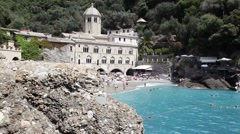 San Fruttuoso, Italy, with sea, beach and people swimming Stock Footage