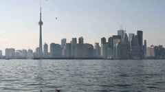 Toronto skyline view across lake Ontario in a hot summer day Stock Footage