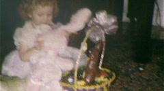 Cute Little Girl Kisses Hugs Bunny Easter Basket Vintage Film Home Movie 289 Stock Footage