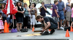 Male artist drawing and painting on city street sidewalks using chalks Stock Footage