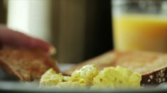 Eating scrambled eggs wide shot Stock Footage