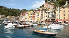 Portofino, Italian charming exclusive village, with sea and boats in port - stock footage