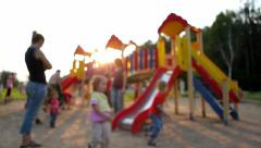Parents play with their children on the playground. Defocus Stock Footage