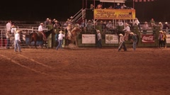 Saddle bronc horse stuck in chute rodeo P HD 9889 Stock Footage