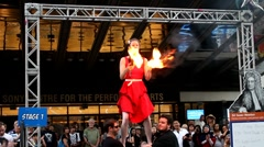 Flaming torch juggling woman in red dress Stock Footage