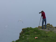 Photographer at Gannet Colony- Weather Clearing Stock Footage