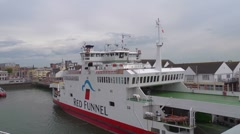 Passing a Red funnel Ferry Moored at Southampton Stock Footage