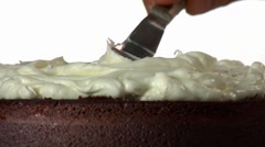 Spreading cream on a chocolate cake Stock Footage