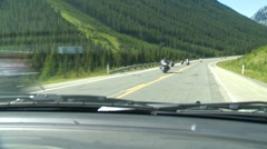 Outlaw bikers on the highway, through the windshield Stock Footage